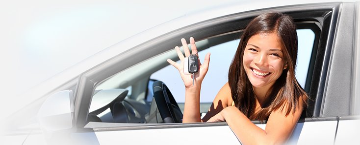 Young woman with her new car keys, ready to set off in her car insured with gap insurance